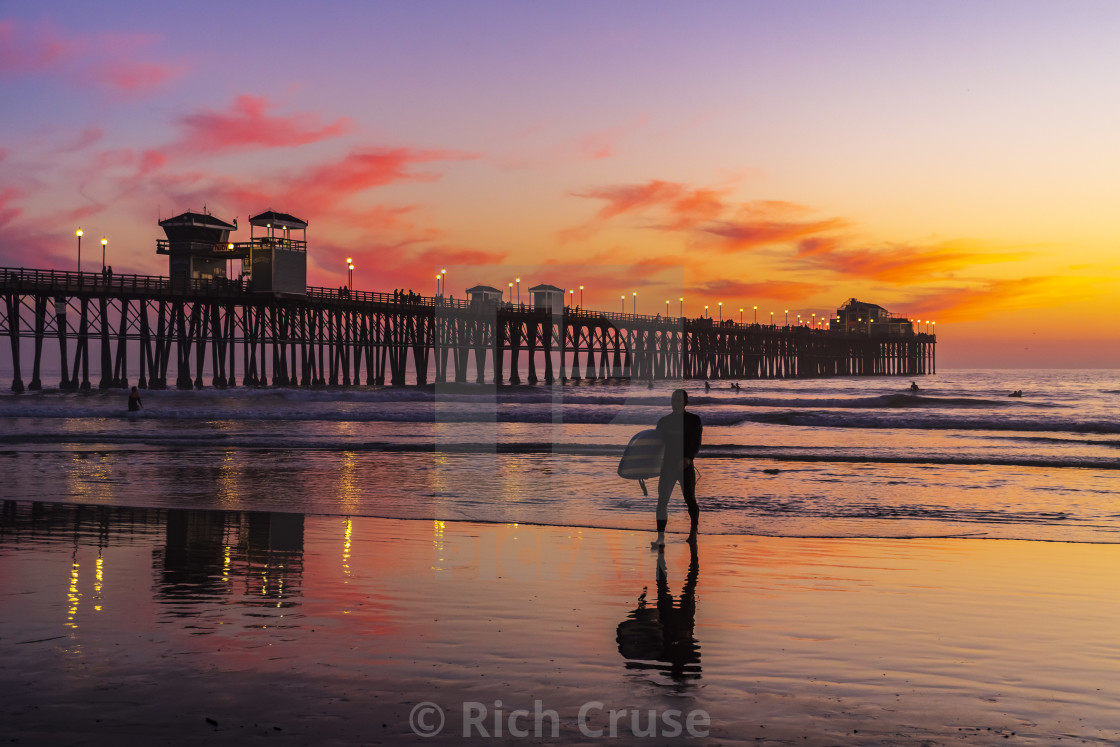 """Surfer at Sunset in Oceanside, CA"" stock image"