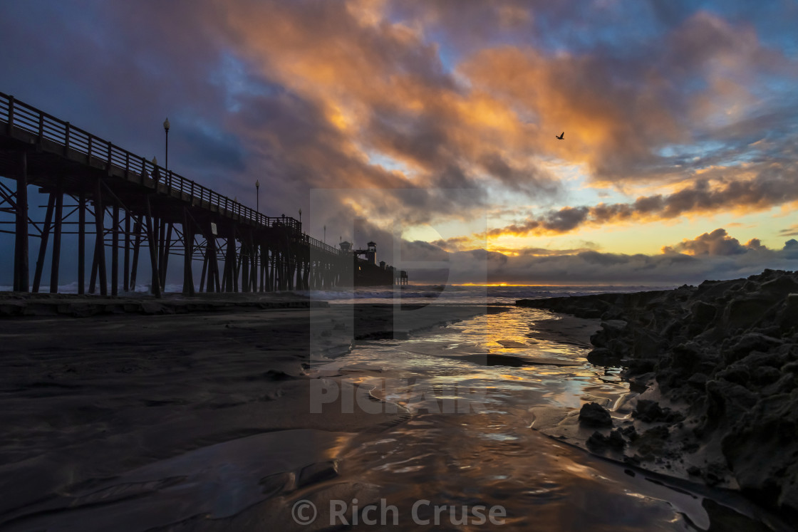 """Oceanside pier in between storms."" stock image"