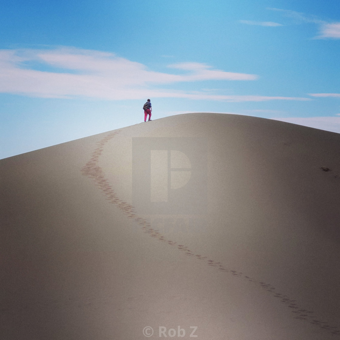 """""""Walking up a sand dune"""" stock image"""