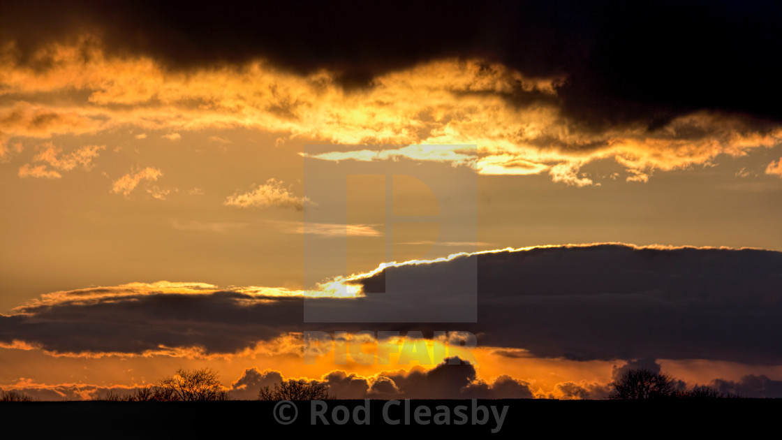 """""""Fire in the Sky 001. Cotswolds evening. Black & Gold."""" stock image"""