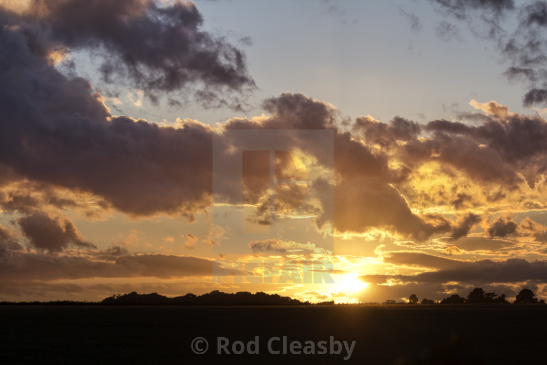 """""""Fire in the Sky 003. Cotswolds evening. Black & Gold."""" stock image"""