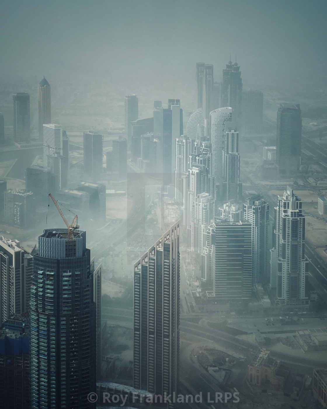 """Downtown Dubai in the morning mist"" stock image"