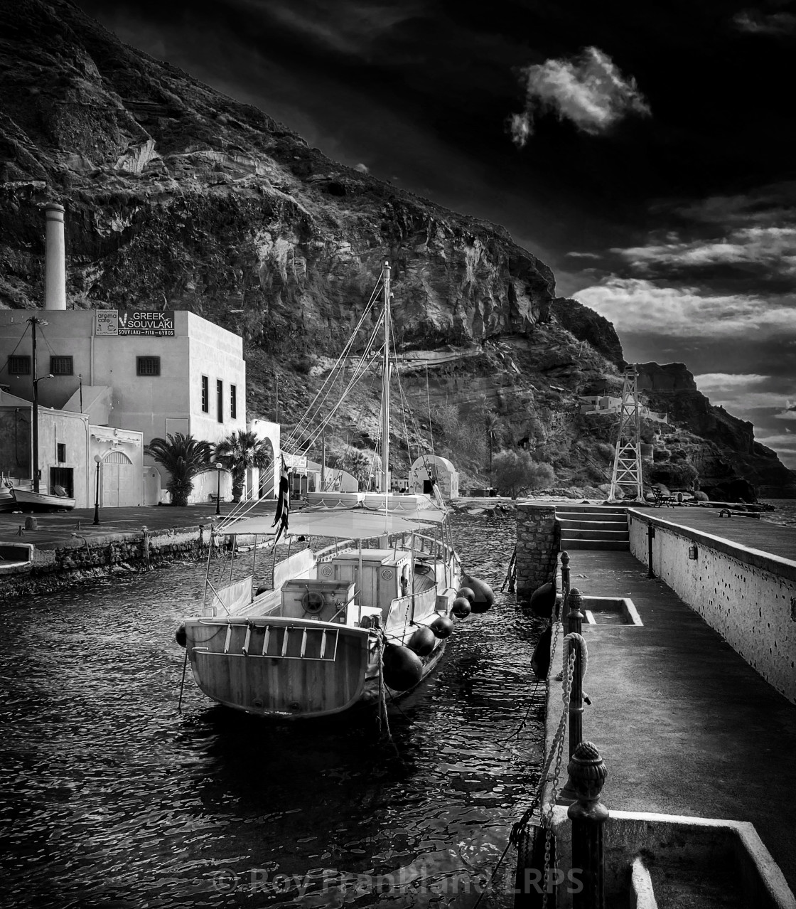 """Fira harbour with sail boat - mono"" stock image"