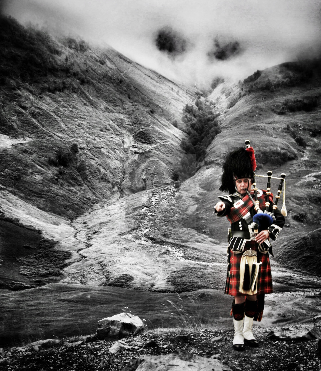 """Scottish piper in The highlands"" stock image"