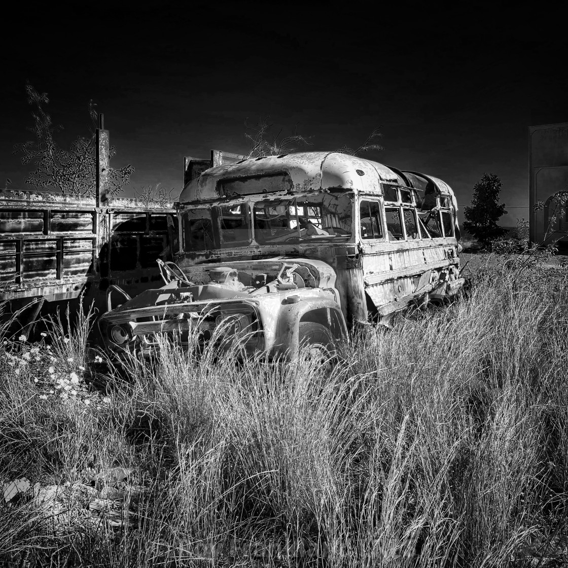 """Wrecked and abandoned bus"" stock image"
