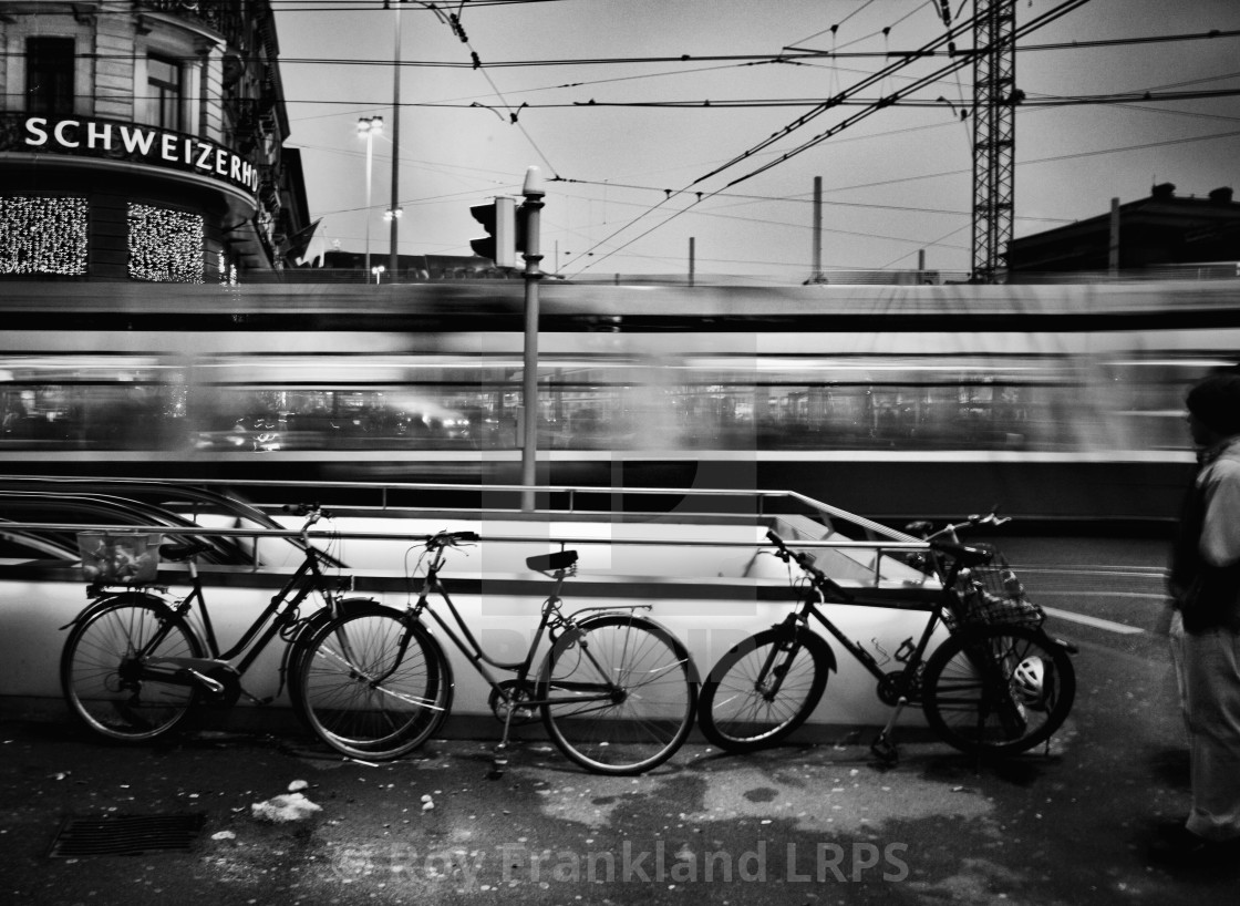 """Bicycles and moving train"" stock image"