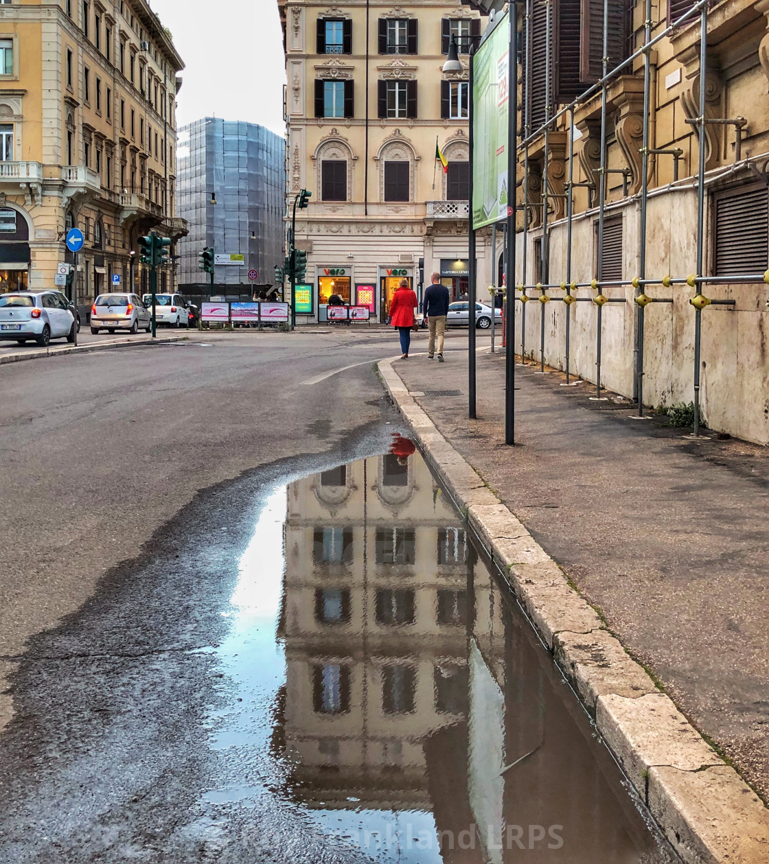 """""""Red coat in Rome with reflection"""" stock image"""