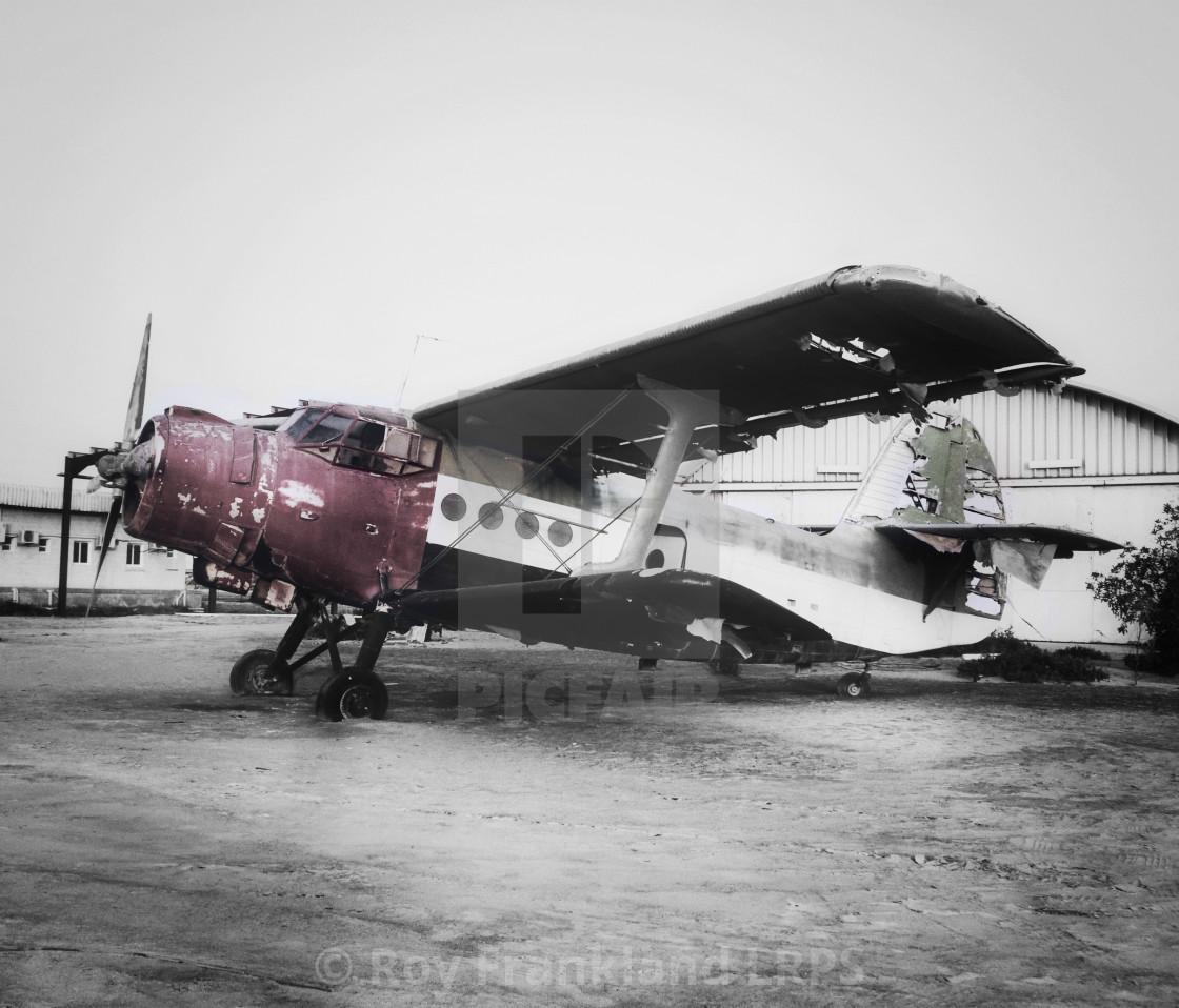 """Abandoned biplane, selectively coloured"" stock image"