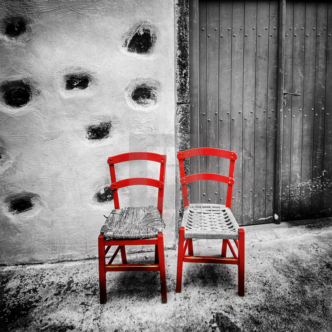 """""""Red chairs, selectively coloured"""" stock image"""