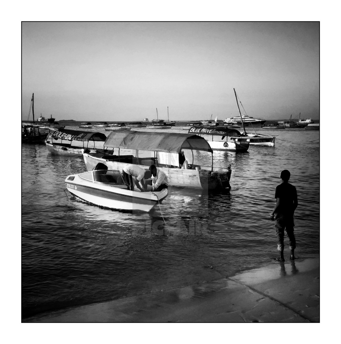 """""""Boats in Stonetown harbour, mono"""" stock image"""