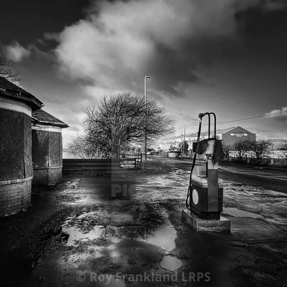 """Abandoned petrol station"" stock image"