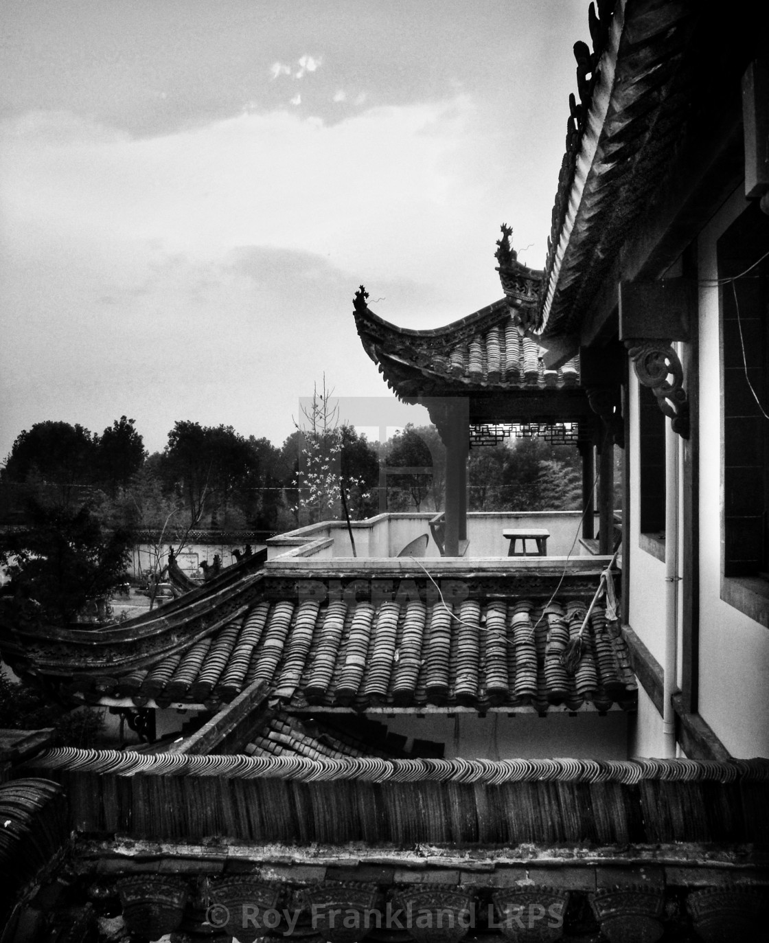 """""""Ancient Chinese rooftops, mono"""" stock image"""