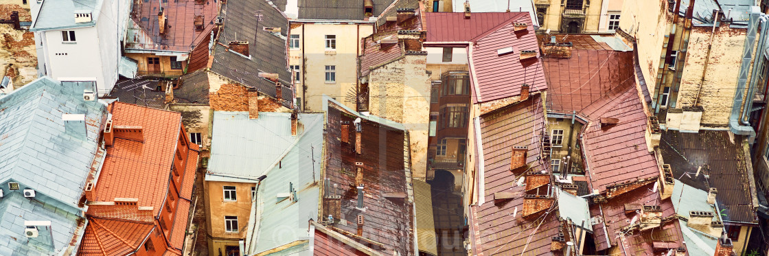 """View of the old roofs. Bright color roofs of houses in historical city..."" stock image"
