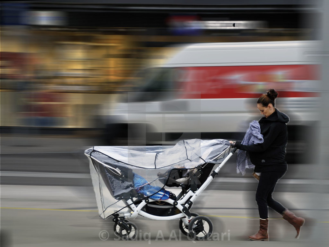 """Mother & Child In Motion"" stock image"