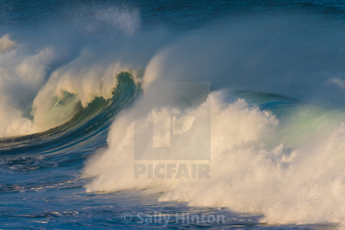 """""""Curling waves crashing down"""" stock image"""