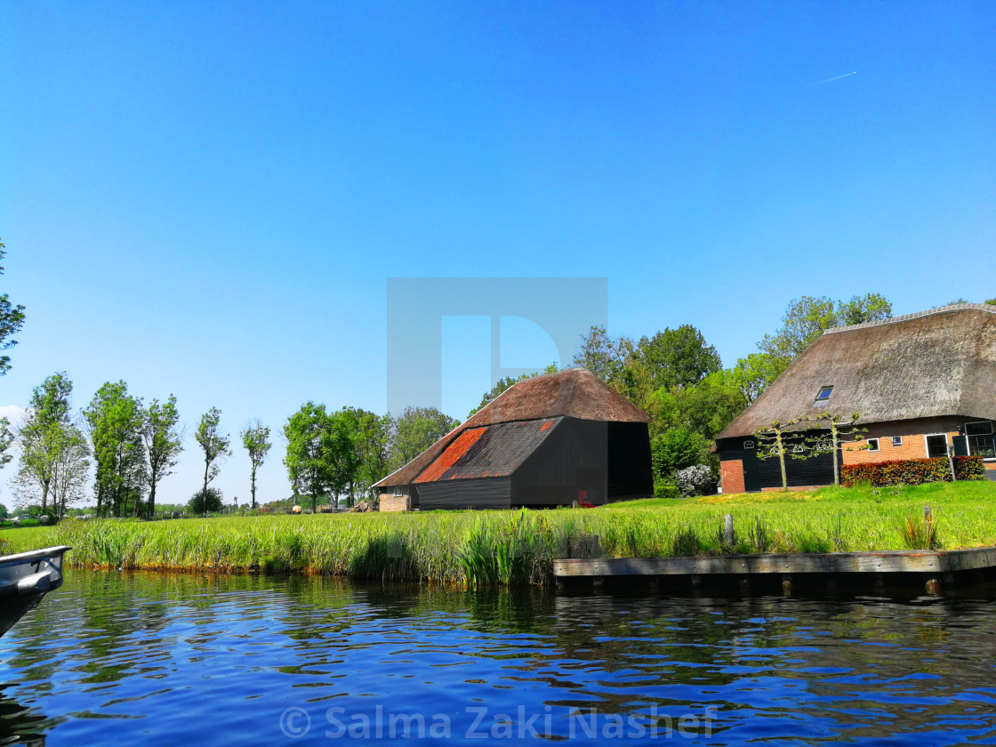 """Cottages At Giethoorn"" stock image"