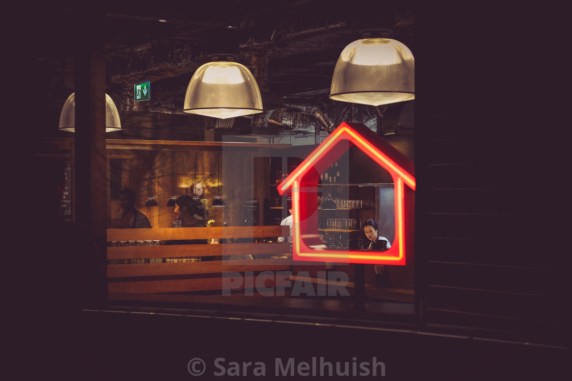"""""""Framed by a miniature house"""" stock image"""