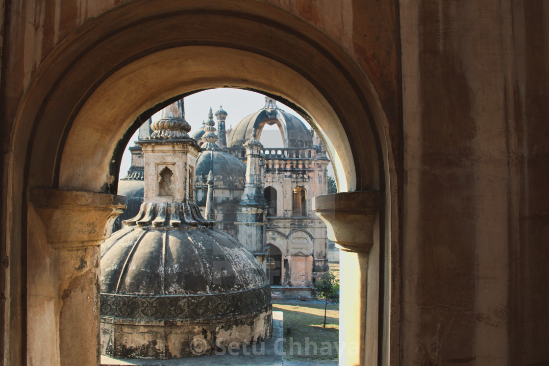 """""""The tombs of some important persons in the history of Surat city seen through an arch, at the Dutch Cemetery."""" stock image"""
