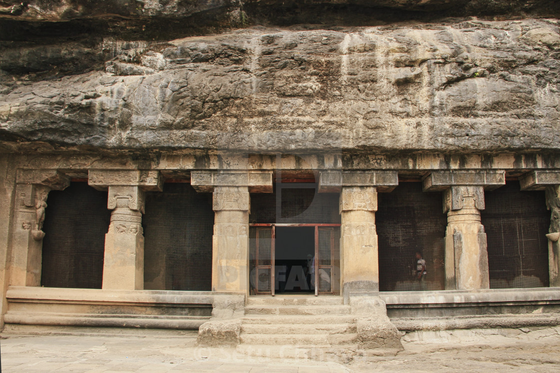 """""""Carved entrance to the cave temple."""" stock image"""
