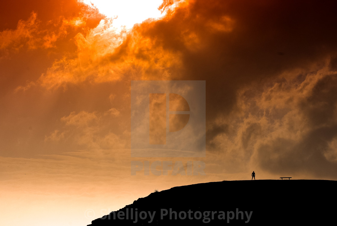 """""""Man on a hill."""" stock image"""