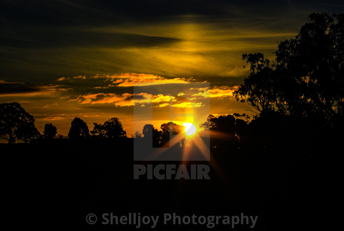 """""""Sunset over the hill"""" stock image"""