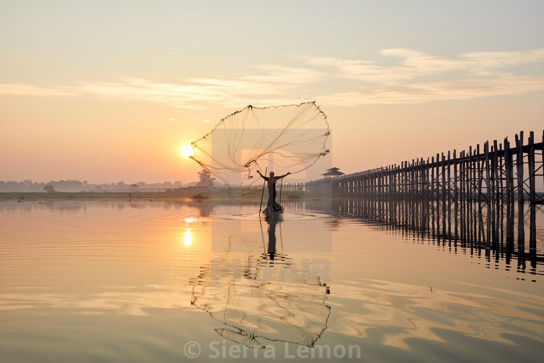 """Fishing at Dawn on a lake near U Bein Bridge, Myanmar"" stock image"