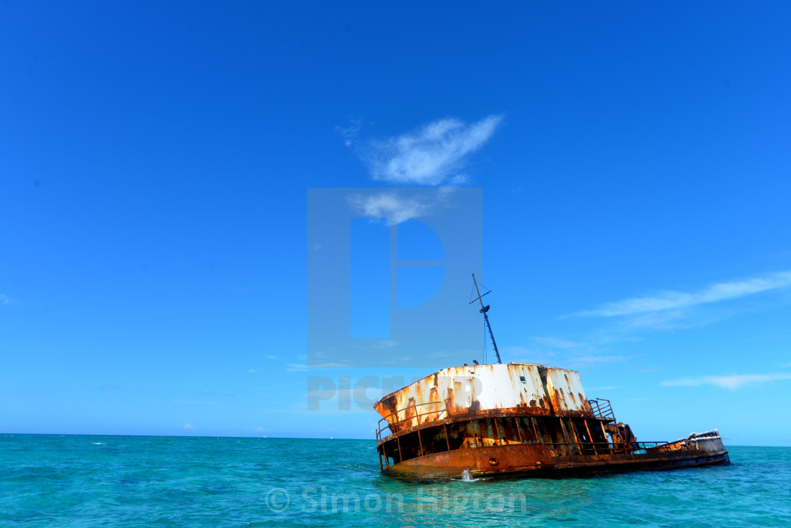 """""""Old shipwreck in the blue"""" stock image"""