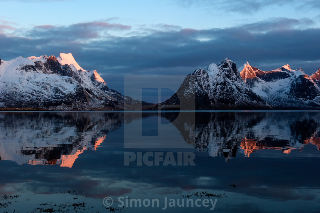 """""""Sunrise on snowy peaks."""" stock image"""