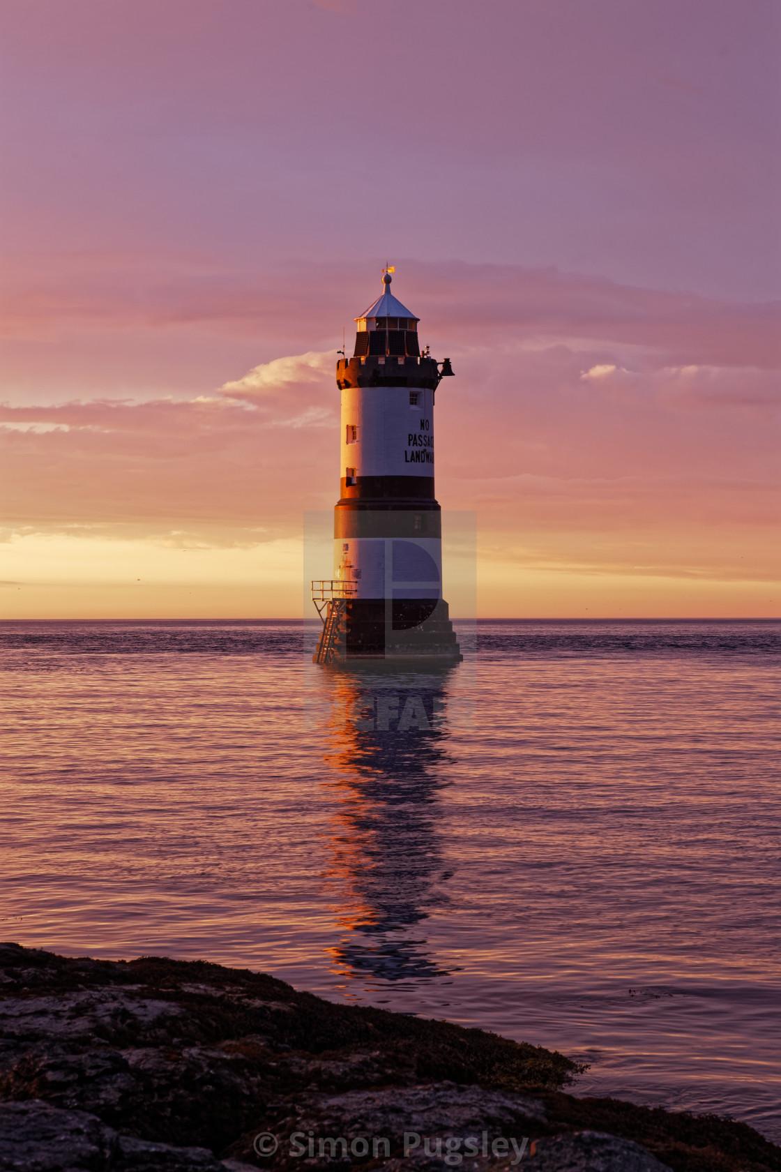 """Penmon Lighthouse at Sunset (Portrait)"" stock image"