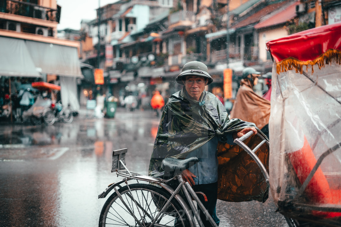"""Cyclist in Hanoi, Vietnam"" stock image"
