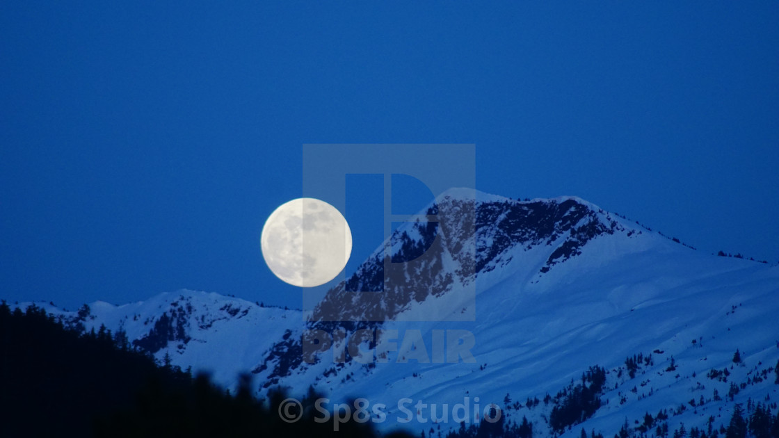 """""""Moon over the mountain"""" stock image"""