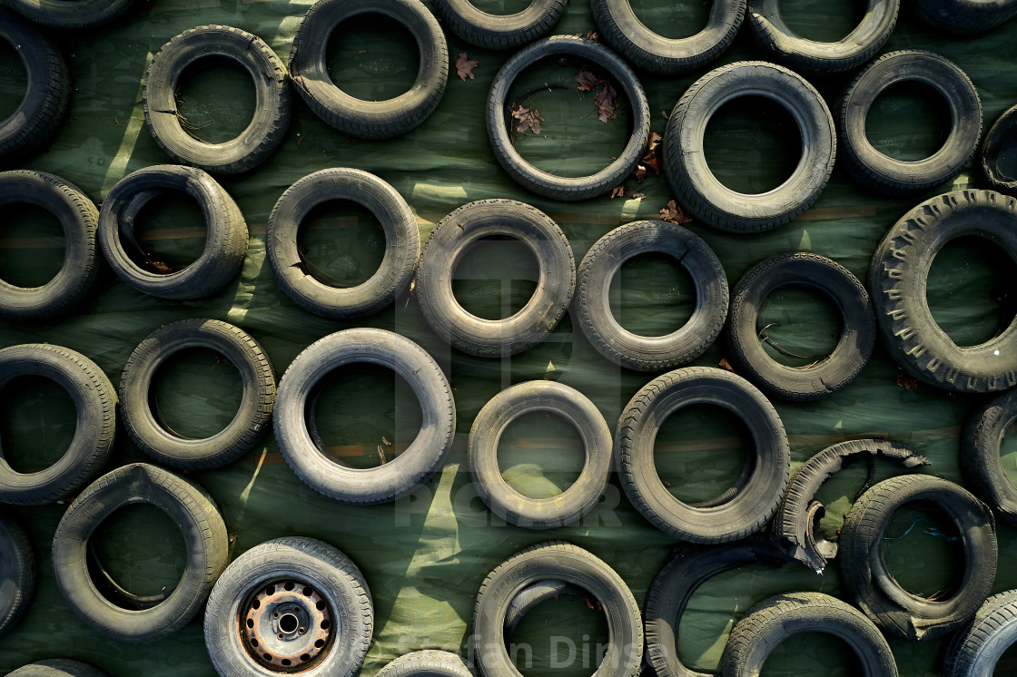 """""""tons of old used tyres in a mix"""" stock image"""