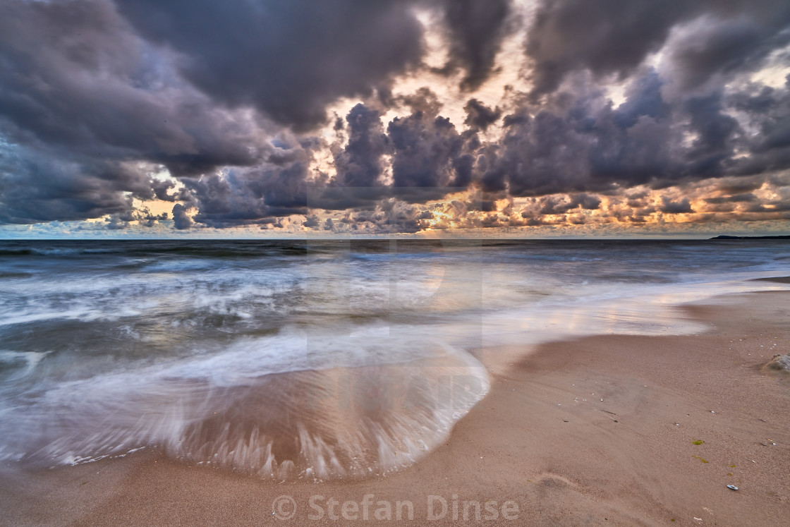 """""""colorful sunrise on beach of baltic sea in germany"""" stock image"""