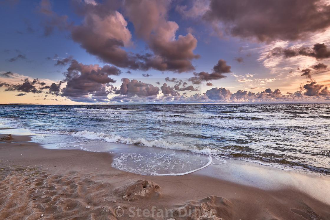 """colorful sunrise on beach of baltic sea in germany"" stock image"