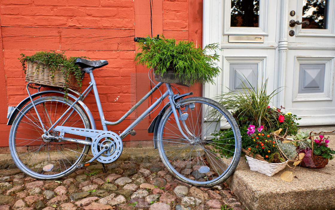 """""""bike with decorative flower pot in front of a house"""" stock image"""