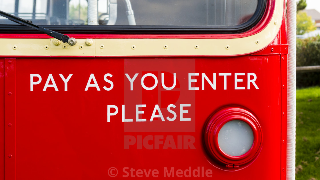 """Pay as You Enter Sign on London Double Decker Bus"" stock image"