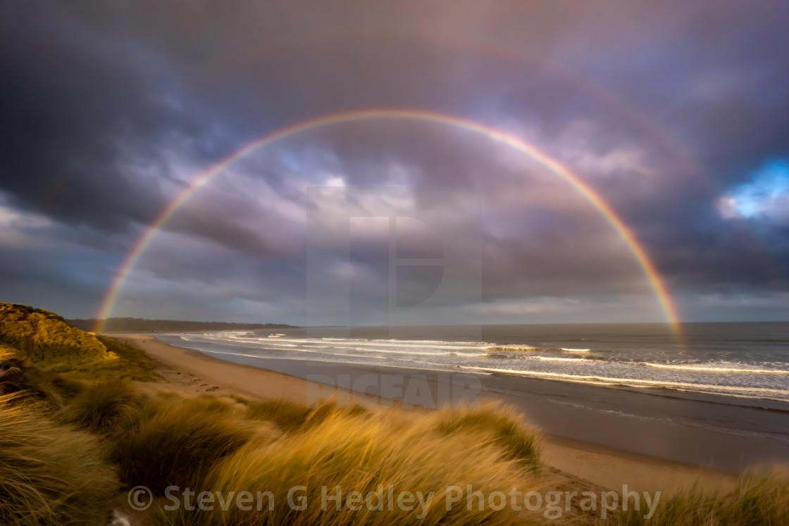 """A Double Rainbow at the Beach"" stock image"