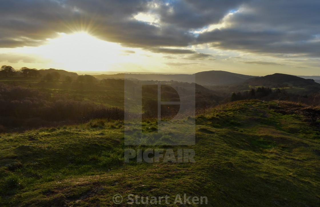 """Evening Sunburst over Caerphilly Mountain"" stock image"