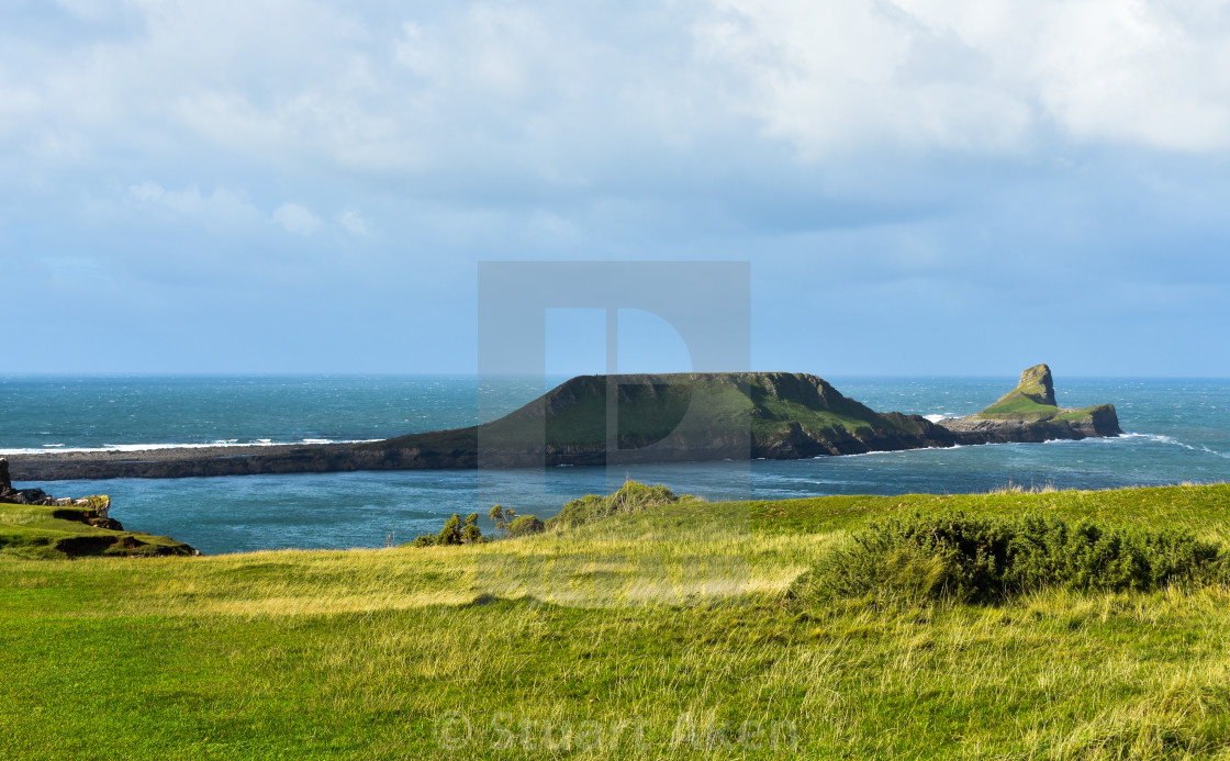 """""""Rhosilli Worms Head in Sunny Gower"""" stock image"""