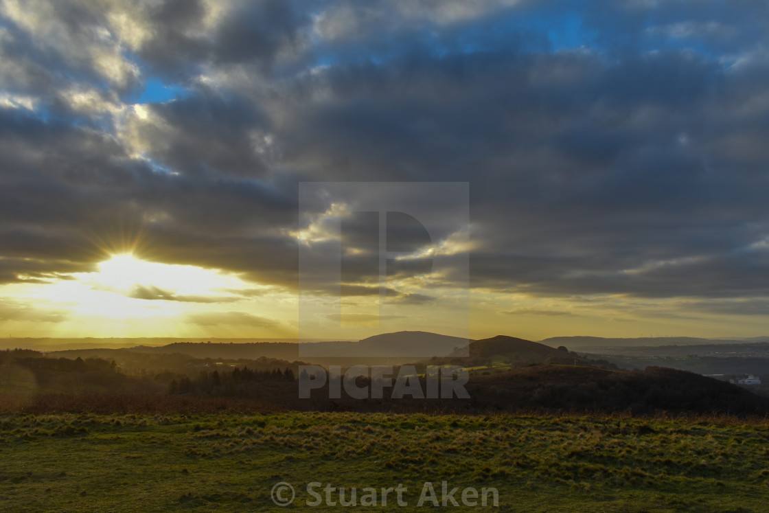 """Sunburst Over Caerphilly Mountain"" stock image"