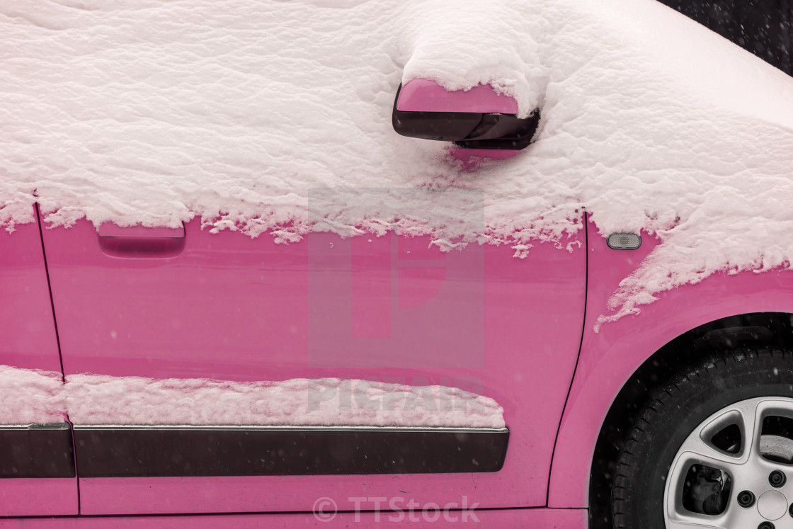 Pink car under the snow