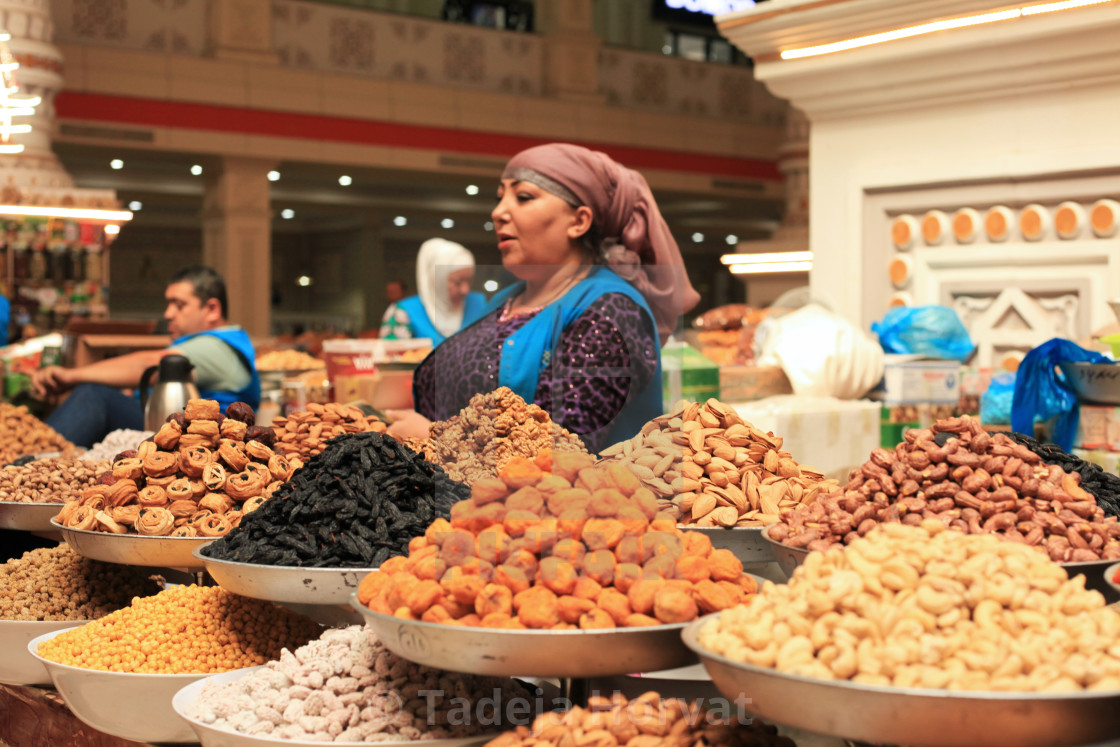 """Women selling dried fruits at the local market"" stock image"