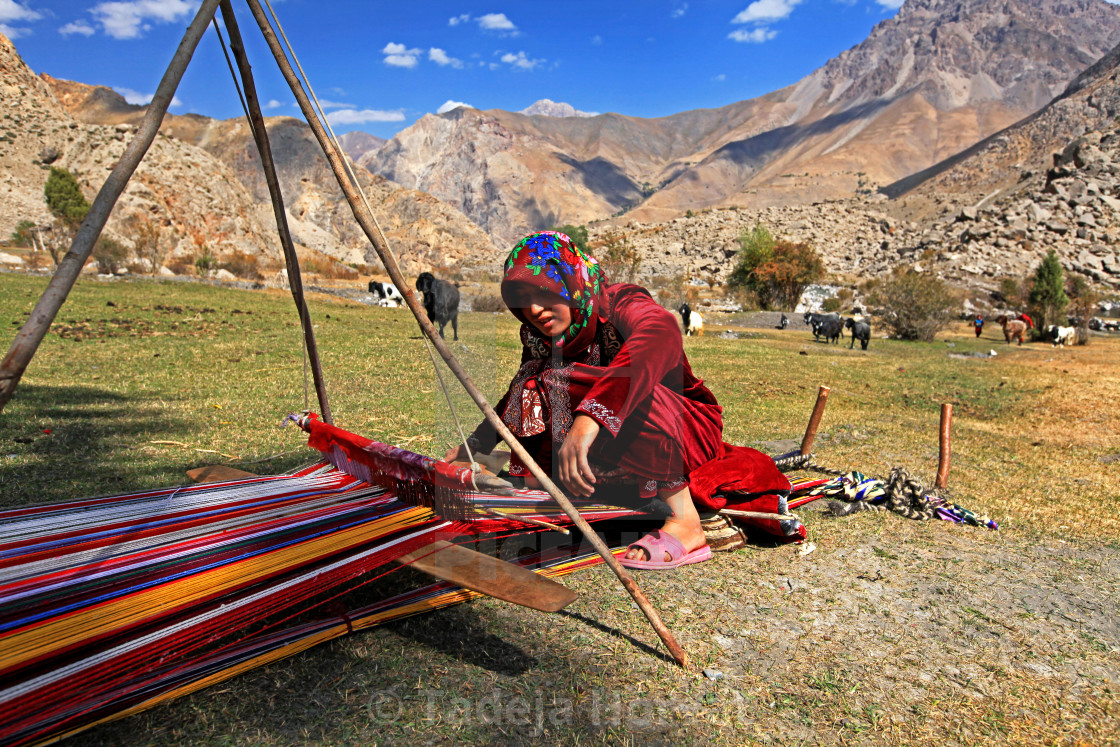 """Girl weaving wool in Fann mountains"" stock image"