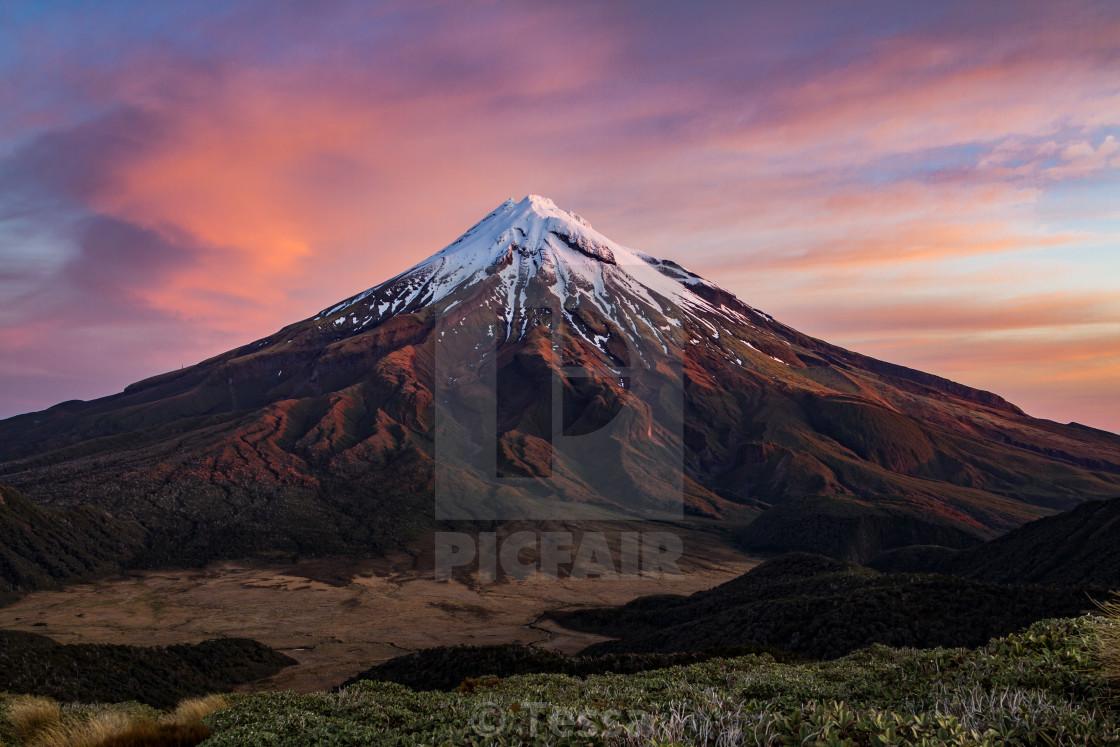 """Mount Taranaki New Zealand at sunset"" stock image"