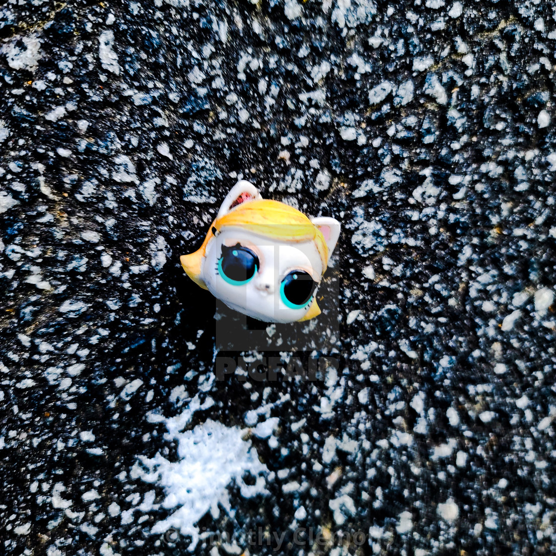"""""""Just a discarded toy head."""" stock image"""