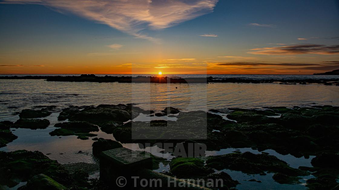 """Sunrise at Stonehaven Bay"" stock image"