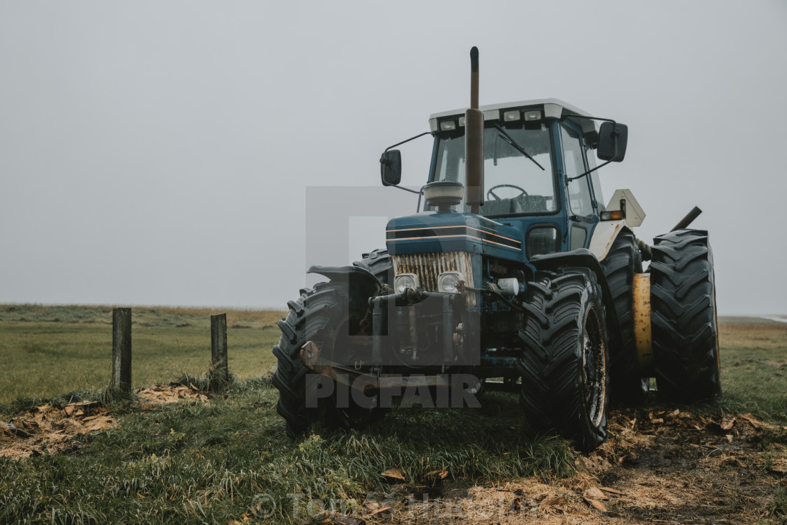 """""""Blue old abandoned tractor on the shore of northern sea in Denmark"""" stock image"""