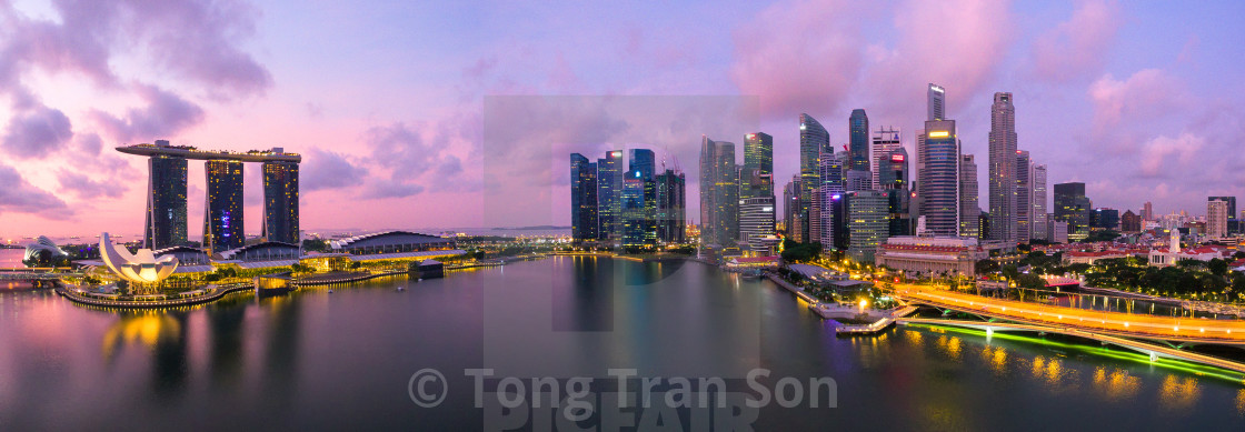 """Singapore,Singapore – July 2016 : Aerial view of Singapore city skyline in sunrise or sunset at Marina Bay, Singapore"" stock image"