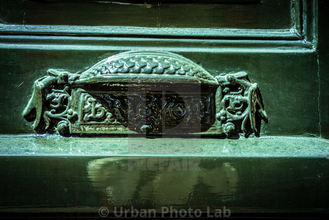 """""""Ornate letterbox in a green door"""" stock image"""