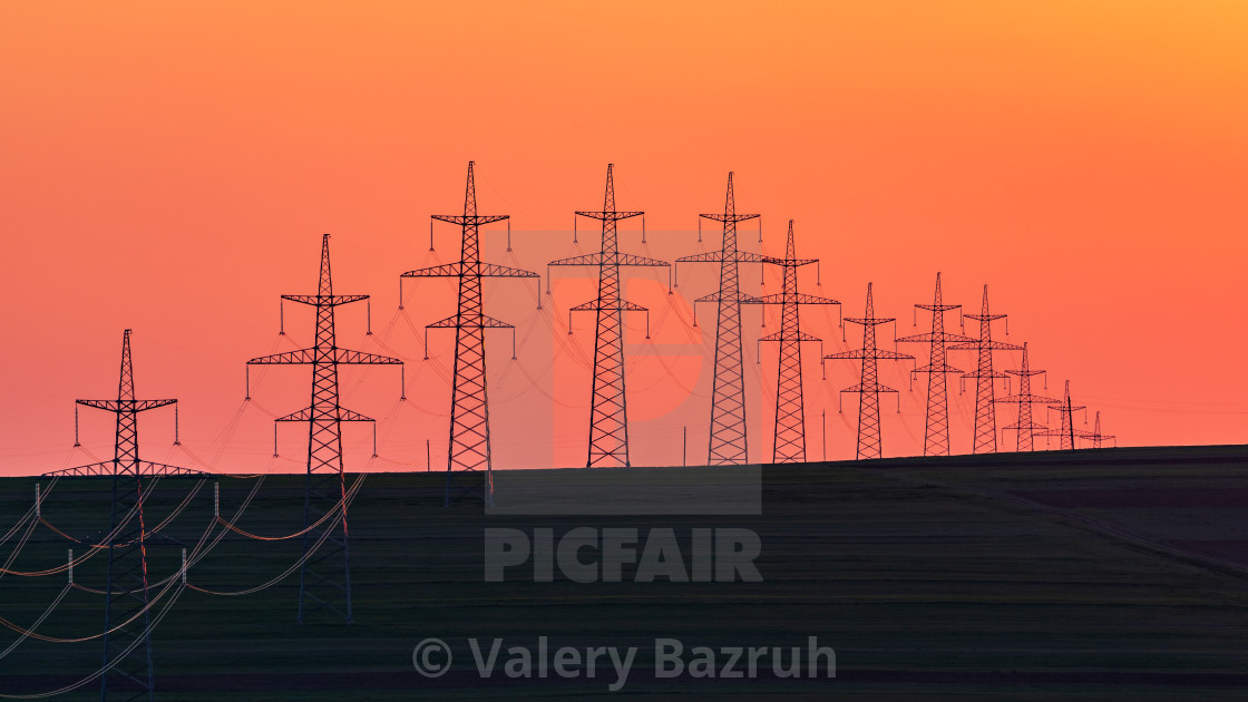 """""""Power transmission towers in the field"""" stock image"""